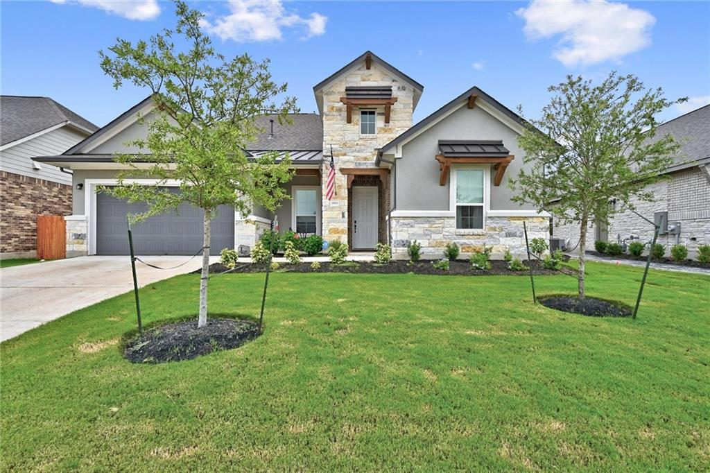 This just looks like a model home! Open floor plan with great light and large windows, no carpet in main areas. HUGE kitchen island, perfect for entertaining! All bedrooms are on the main floor with the game room on the second floor with a full bath.