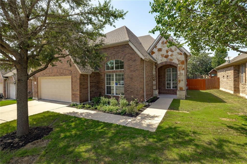 Welcome to this move-in ready all-brick with stone accent 1-story home in the highly desired Twin Creeks neighborhood! A covered front patio welcomes you as you walk up. Upon entering the foyer, to the left is the dedicated office overlooking the front yard!  As you walk down the hall the home features a formal dining room along w/ updated designer selected light fixture!  This home is a split floorplan with the 2 secondary bedrooms down the front hallway near the laundry room and updated bathroom. Notice no carpet throughout the home!  As you enter the kitchen note the custom pantry and updated kitchen showcasing granite countertops, updated backsplash, center island, breakfast bar, SS appliances, and custom lighting.  The kitchen overlooks the eat-in kitchen designated area perfect for your breakfast table and chairs as well as overlooks the spacious family room that includes a cozy fireplace and windows overlooking the backyard. Natural light fills the home through the large windows. There is also an EV charging outlet  (NEMA 14-50) installed in the garage! Enjoy outdoor activities while having a sense of intimacy in your fully fenced-in backyard. Enjoy first-class club facilities and community amenities, including a private clubhouse with dining facilities, community walking trails, a community recreation center and a water park featuring a junior Olympic-sized pool and zero-entry resort-style pool. The Twin Creeks Community is just minutes from Lake Travis and approximately 25 miles from Downtown Austin. Nearby Twin Creek Park for more fun outdoor activities and highly-rated schools!