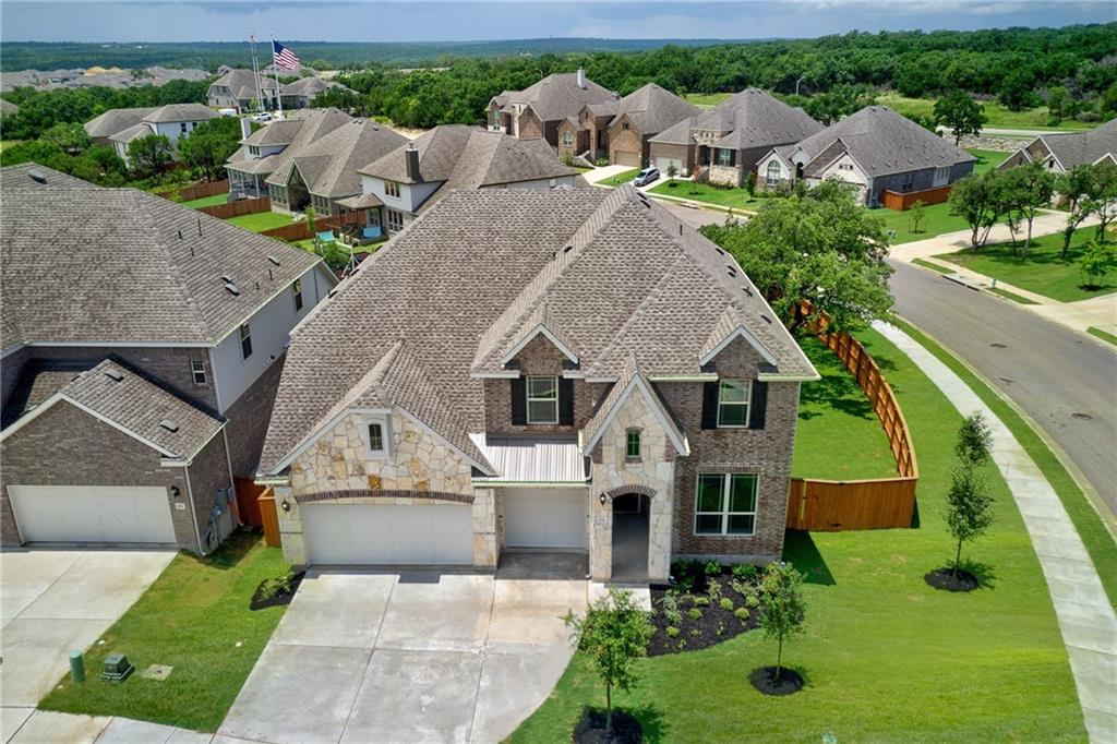 Beautiful BRAND NEW (never been lived in) 4 bed, 3 and one-half bath, 3 car garage in the highly sought after community of River View!!! GREEN BELT CORNER LOT with no side or NO BACK NEIGHBORS located within Georgetown ISD. This home offers a 2 STORY LIVING ROOM, large master suite, enlarged master shower with drop in tub, huge game room and 3 additional bedrooms up. Gourmet kitchen with granite countertops, built in stainless steel appliances, formal dining room and an office. Large covered patio overlooking an oversized back yard with beautiful mature trees. 3 miles to Wolf Ranch Town Center shopping, movie theater and restaurants.
