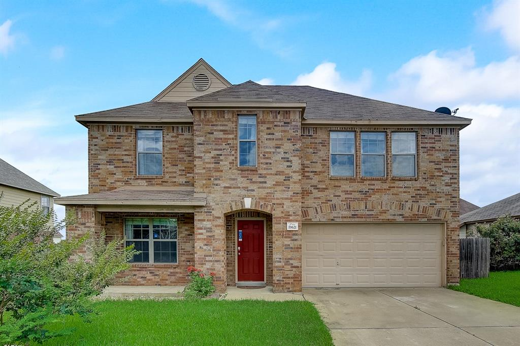 This Round Rock two-story home offers a patio, and a two-car garage.