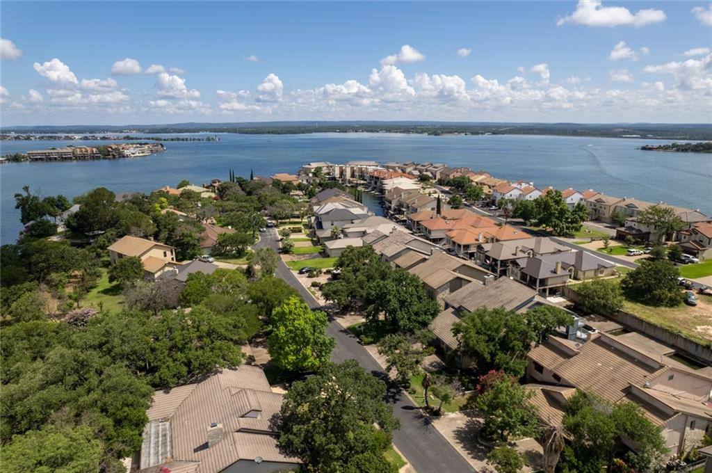Affordable LBJ Waterfront Townhome with tons of room for the entire family.  This 3019 sq foot home boasts 3 bedrooms and 4 1/2 baths so can easily host your family get togethers.  It includes a boat stall, boat lift and expansive patio space for cookouts and parties.  This home won't be on the market long with the full time water access that it offers.