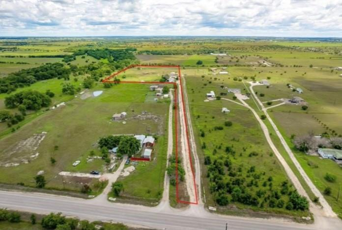 Opportunity to own your own piece of central Texas. 10 ACRE tract located in Florence with 2 mobile homes. Both homes where built in 2000.  Main home is 5 bedroom with 3 bath have central HVAC with window units. Second home is 3 bedroom with 2 bath with window units and space heaters. Each home has its own septic. Florence ISD. Property is fully fenced with goat fencing.