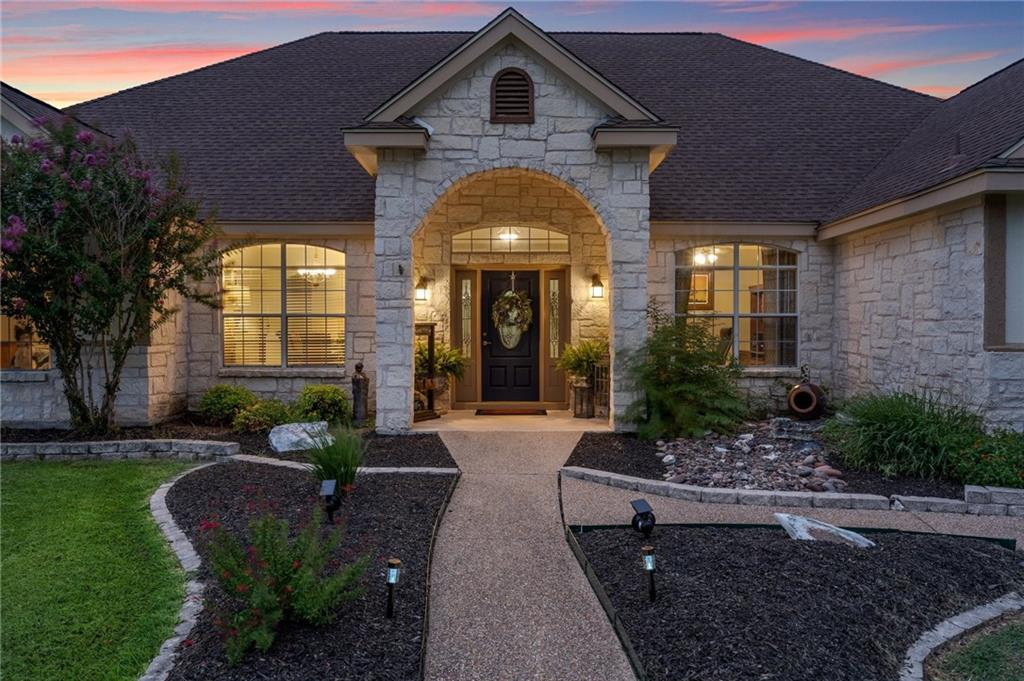 Welcome to the prestigious Gabriel's Overlook. A well desired gated community located in the hill country of Georgetown Tx. This custom built, luxuriously updated home sits on almost 1.3 acres, plush with mature trees and beautiful curb appeal. Only walking distance to the San Gabriel River, you'll find this home to be perfectly located. This home boasts an array of sleek features such as: designer Brazilian Cherry hardwood flooring, vaulted cathedral ceilings, a masterful gourmet kitchen, oversized bedrooms, and a flawless master suite. Entertain friends and family in the huge private backyard complete with a hot tub and a sparkling inground pool perfect for a Texas summer. You do not want to miss this spectacular home! Schedule a tour today!