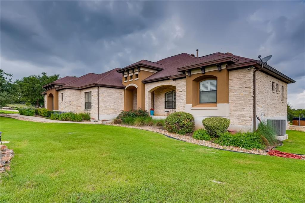 Perfect opportunity to own your own piece of Texas, with approximately 5 acres of lush landscaping & unbeatable views! NO HOA OR HOA FEES! No detail has been overlooked in this incredible floorplan features decorative art niches, arched doorways, tray ceilings, plantation shutters in nearly every room & beautiful floors throughout the homes open, airy layout. The gourmet kitchen provides  cabinet space, gorgeous countertops, stainless steel appliances, a large center island & a breakfast bar with stone accents. Take advantage of the executive study where you can work from home, or unwind in the large living room showcasing a floor-to-ceiling fireplace. Retreat to the master suite offering private backyard access, dual sink vanities, a custom walk-in closet with built-in features & bath perfect for relaxing after a long day. You will love the laundry room which features a large single-basin sink, a linen closet & room for a freezer! Enjoy outdoor living on the huge covered patio offering a built-in grill & beverage fridge, and then step onto the extended open patio overlooking the well manicured lawn & peaceful views. Additional features include a private gated entrance & driveway & a huge 3-car garage with conditioned office space, a workbench & built-in cabinets. Internet is offered through Suddenlink, good for 200 mbps downloads, with VOIP landline service as well.