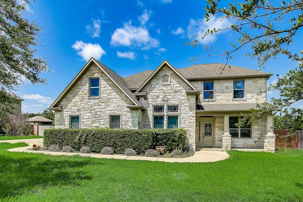 This Austin home features granite countertops and a three-car garage.  This home has been virtually staged to illustrate its potential