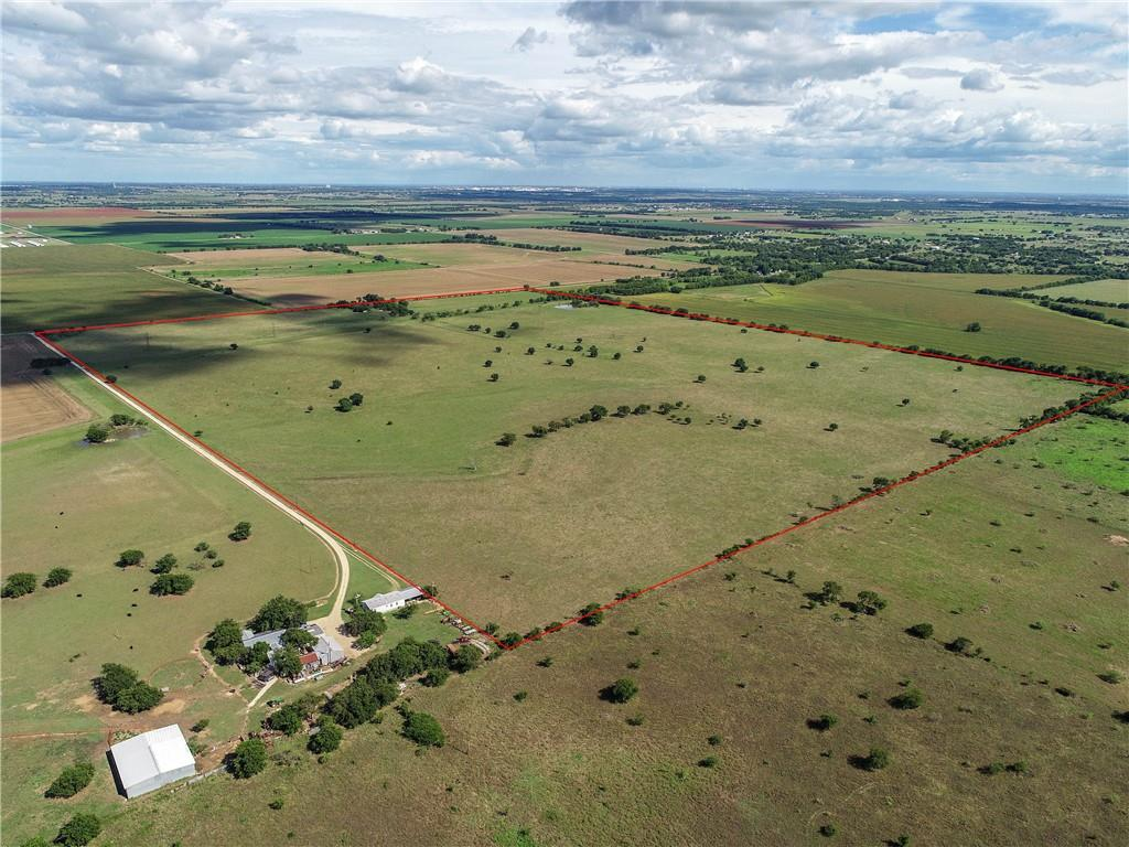 Country getaway for ranching, recreation, or your next home. 154 +/- acres of gorgeous pasture land with multiple potential homesites near Belton Lake in Bell County, and just 16 miles from Space X in McGregor. Will subdivide in tracts as small as 50 acres. With 2,300 feet of FM 2409 frontage near Moody, the shape of the property lends itself to multiple homesites with countryside views. The fertile pasture features 30+/- feet of elevation change from east to west and includes multiple seeded grasses such as Bermuda, Kleingrass, and others. Trees include pecans, hackberry, cedar elm, and pear. Come build your home, or multiple homes with a view of the pastoral countryside, and run your own cattle, or continue a cattle lease with the current rancher. The Kell Branch which flows into Lake Belton starts on the northeast part of the property with a seasonal flow. The pond on the southeast corner holds water during most years. Light restrictions will apply (see documents).