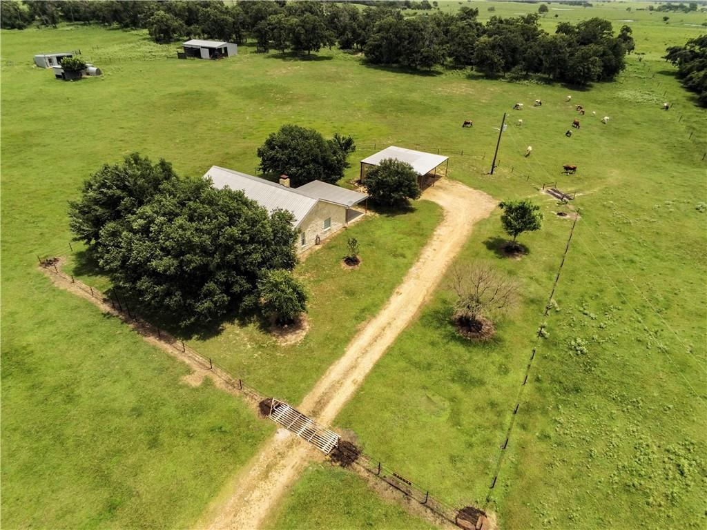 Gentleman's Ranch in the heart of beautiful farming/ranching community with lots of elevation changes and scenic views in every direction! 17.41+/- acres with a 3/2-1,612 sqft. Austin Stone home with detached 20'x30' 2-car carport w/10'x30' workshop. The workshop has concrete floors, decorative wood-paneled walls, a set of double doors and a ceiling fan. The property is fenced for cattle and has a stock pond, a 30'x40' metal barn w/electricity, water and two stalls for horses, a steer-roping arena, chicken coop and playhouse.  This sweet, little family ranch is tucked off of the road and down an easement lane with beautiful, panoramic views and lots of privacy.  If you're heading to town and in a hurry, take a right to go to Fedor, the famed Fedor Store and FM 1624 or go left to wind your way past gorgeous views of surrounding hay pastures and ranches, over the Old Iron Bridge at the Yegua Creek and on in to Lexington.  Either way, it's about 15 minutes from Lexington or Giddings and the views make it worth the drive! *All appliances convey. *Living Room, spare bedrooms and bath flooring replaced in 2018. *Majority of interior walls have been newly painted.