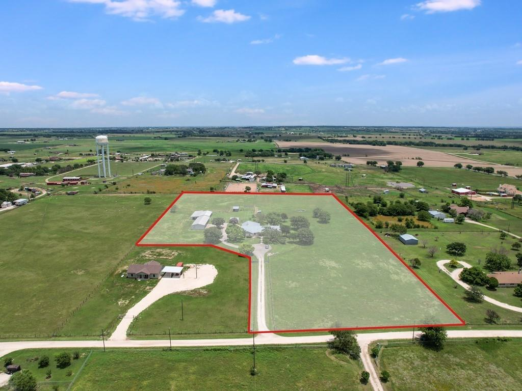 Don't miss this awesome opportunity with possibilities abound! Potential for a business or live/work situation! Ideally set up for your livestock to roam on 8.2 acres in the tranquil countryside of East Georgetown, with no known restrictions and a low county tax rate of 1.86%. Current ag exemption in place. Panoramic views of pastureland and sky! The property features a 143' long metal building with multiple stalls and pens, plus two enclosed storage areas on slabs. Ideal for animals, trailers, equipment, and more. A 20'x24' storage shed/workshop houses well components and is complete with electricity and water. Two more metal animal shelters are located in the pastures. Trojan Horse Walker in front pasture. Land is fully crossed-fenced with an automatic electric gate at the driveway to the home. From the acreage to the well-maintained home, pride of ownership shows throughout. Home is solidly built with all sides white stone, metal roof, and a 2-car attached garage. Extensive updates over the years include tile, carpet, and vinyl plank flooring, interior and exterior paint, double-paned vinyl windows, and primary bedroom and bathroom renovations. The flexible floor plan features 4 large bedrooms, 3 full and one-half baths, a study/hobby room, and a large game/bonus room. The open kitchen features double ovens, and a spacious laundry room has a separate sink. Beautiful large trees provide shade all around the homesite. The extended covered back patio is the perfect place to enjoy this amazing property and the peaceful country life that comes with it!