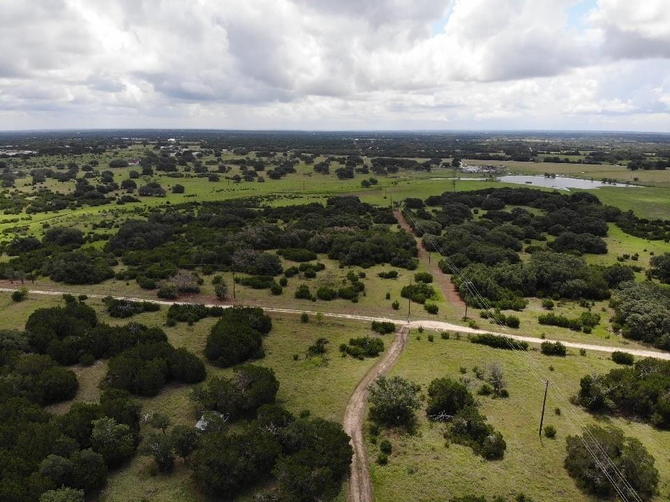 20 fully fenced acres on the outskirts of Burnet with tons of potential. NO ZONING! 2 outbuildings on the property that provides covered storage for equipment of all shapes and sizes. Land provides hunting capabilities and much more! The tract is level and contains scattered trees. This property is the tract of land you've been waiting for with room to grow.