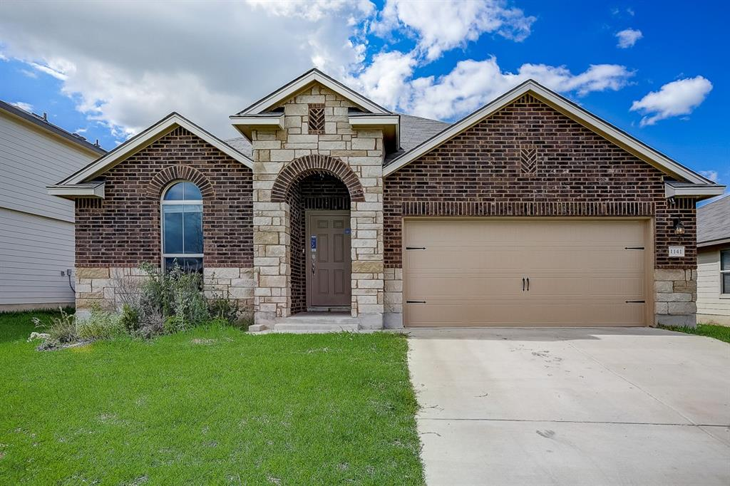Built in 2019, this Jarrell one-story home offers granite countertops, and a two-car garage.