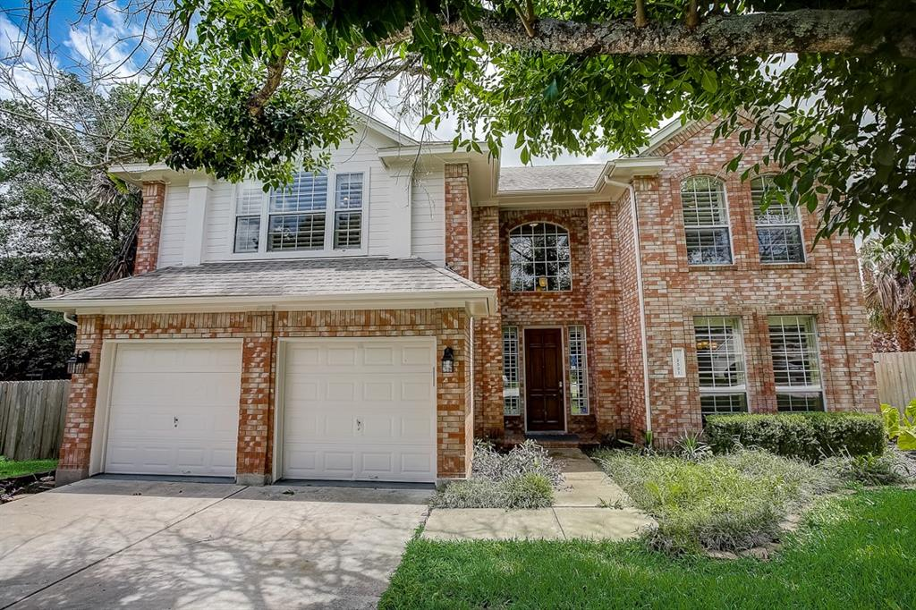 This Pflugerville two-story corner home offers an in-ground pool, granite countertops, and a two-car garage.