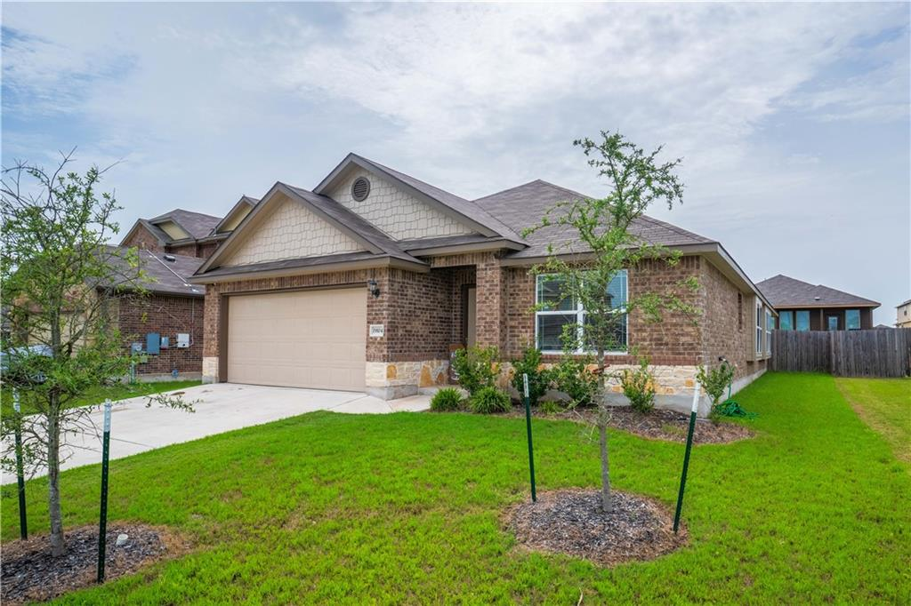 Located in Verona, one of Pflugerville's sought-after neighborhoods, this single-story beauty features fabulous, modern finishes, a wide-open floorplan, and soaring ceilings with lovely architectural touches. As you step inside, the natural tones rush to greet you, and you'll love the ceiling detail and arches. Complete with a dedicated office, the flexibility of this space was designed just for you. The comfortable living area is outfitted with upscale finishes and adjoins the well-equipped kitchen and sunny eating area. Sure to make your favorite culinary enthusiast swoon, the kitchen features a large island, stainless steel appliances, plenty of sparkling granite countertops, espresso cabinetry, tile backsplash, and pendant lighting. Private and serene, the owner's retreat comes complete with a garden tub, separate shower, dual vanities, and a walk-in closet. The spare bedrooms are nice-sized and feature neutral tones. Nestled in a prime location, this home is moments from awesome shopping, great restaurants, golf, Kelly Lane Park, Typhoon Texas Water Park, major employers, and main roads like TX130 and TX45. Welcome HOME!