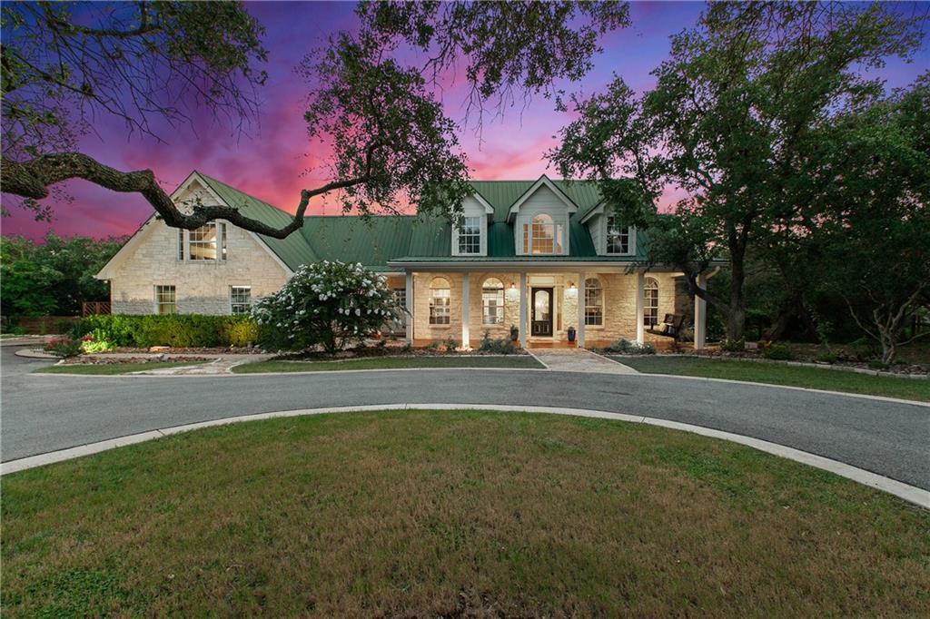 A rare opportunity to own a gorgeous custom home sitting on a 2.13 acre private lot in Triple Creek Ranch one of the most coveted dark sky gated communities in Dripping Springs! This stunning property offers beautiful landscaping, mature oak trees, a private park like setting, endless hill country views, and backs to a wet weather creek. Gorgeous curb appeal with a regal circle driveway lined by beautiful mature oak trees, and an oversized front porch with a swing welcomes you home. This 4 bedroom, 3.5 bathroom, 2,745 SQFT open-concept home offers a formal dining, a private master suite overlooking the backyard, spacious secondary bedrooms, an upstairs guest room with an updated ensuite bathroom, and a large mudroom with built-ins. Other interior features include vaulted ceilings, an elegant stone fireplace in the main living room, updated kitchen with an abundance of storage and high-end finishes, and updated bathrooms. Stunning enclosed backyard with views. 75 live oaks in approximately 1.5 acres maintained space, with separately fenced pool & fenced-in yard with dog door access. An elegant waterfall pool with sundeck, multiple outdoor living areas, playground and entertainment areas, and amazing hill country views! Smart controlled pool and landscape lighting and 14-zone smart irrigation system. The exclusive Triple Creek Ranch is minutes to downtown Dripping Springs, and close proximity to local breweries, restaurants, distilleries, and wineries. Just steps away from private neighborhood access to swimmable Barton Creek, this is a true escape from city living! Low tax rate and DSISD schools.