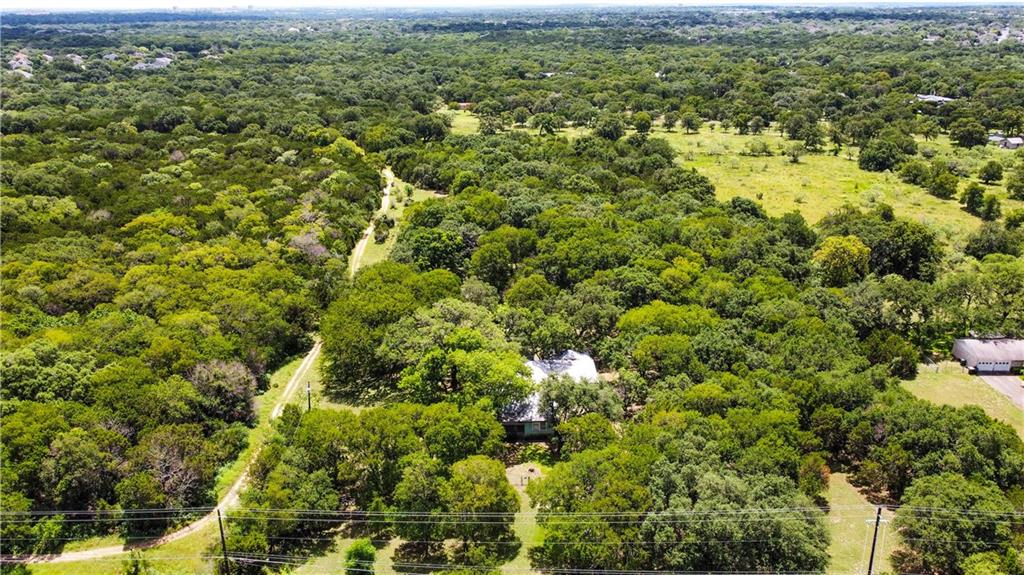 5 acres within the city limits of Sunset Valley. Home on the property is being sold as is condition. Great development opportunity.