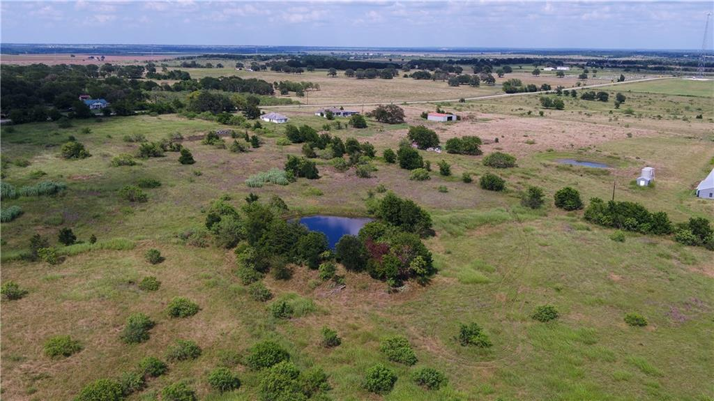 16.803 acre tract located in Milam County, just off of FM 487 N on CR 415 near the Sharp community.  This tract has a nice view and no nearby houses! This property also has a pond in the rear and great area for a possible additional pond too. Good pasture land that is ag exempt and partially fenced. Located in a nice, quiet area and will make a nice home site or weekend retreat. There are white-tailed deer, feral hogs, native game animals, waterfowl, and game birds in this are as well.  Great location for your needs--only 45 miles form Austin area, 60 miles from B/CS and 35 miles from Temple.  Minimal restrictions will be placed on the property: no mobile homes and no trash/junk cars. Power line runs along the county road.  Adjoining tract of same size is also for sale, same price.