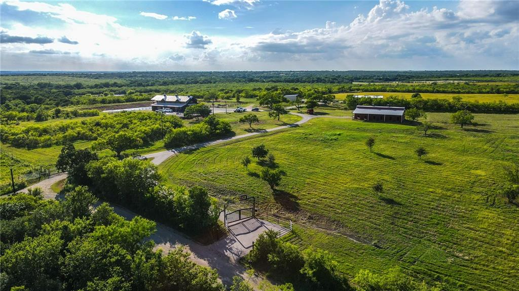 Ranch buyers and real estate investors looking for a turnkey showplace near Austin and Tesla will appreciate the J Ranch in Caldwell County. J Ranch is conveniently located 22 miles south of Austin Bergstrom International Airport, just north of Lockhart, TX. Lockhart was officially named the BBQ capital of Texas by the 76 th State Legislature and is one of the fastest growing, culturally rich small towns in central Texas. Discerning buyers will appreciate the thought that has gone into designing and building this 118- acre ranch. J Ranch is highlighted by exceptional, first class improvements for entertaining and luxury ranch living. The newly constructed, 8,286 sqft custom barndominium has 5,556 sqft of heated and cooled living space with no detail overlooked. The construction and finish work are of the highest quality, creating what is arguably one of the finest structures in the area. Rounding out the ranch improvements are a custom horse barn, ready to be completed to buyer's specifications, complete with an executive apartment. Toys and tools can be stores in the 3,000 sqft enclosed, insulated workshop with a full bathroom, and equipment storage in the 30X40 pole barn.