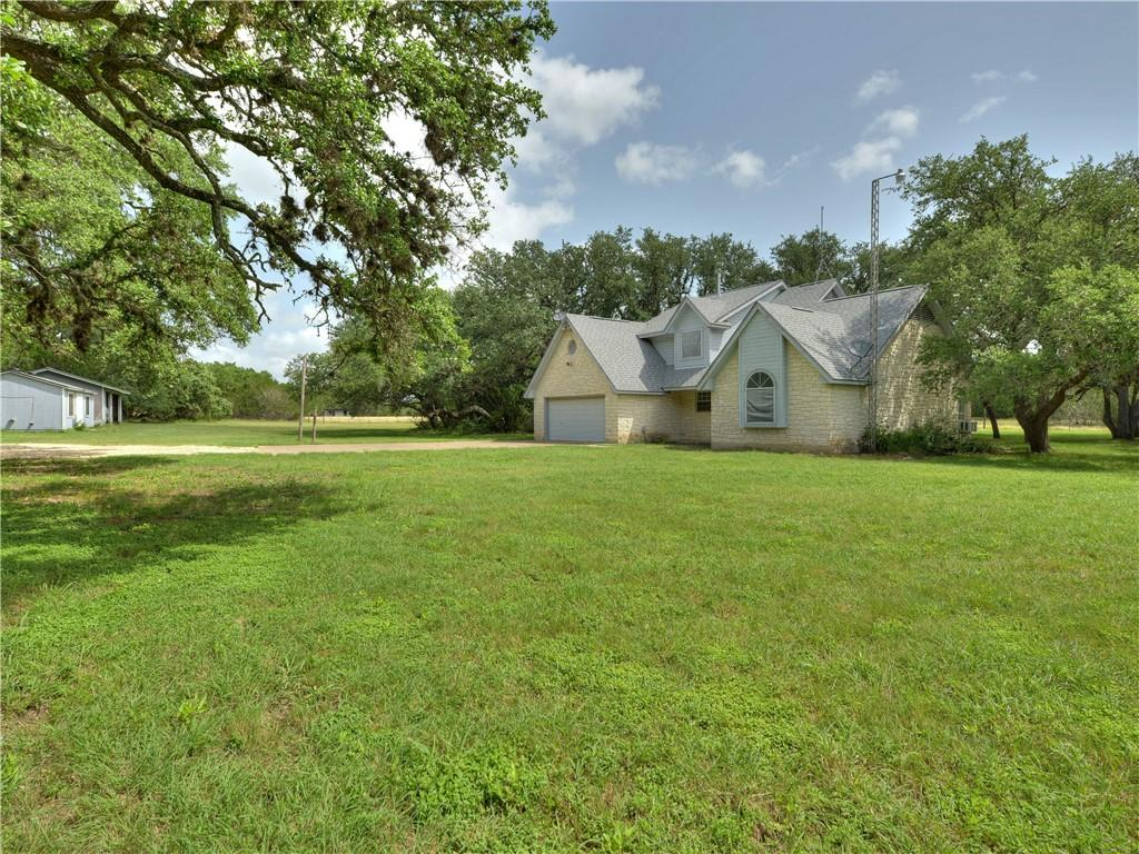 Beautifully wooded 14+ acre property in Liberty Hill ISD. Currently Ag exempt, this property has no known deed restrictions. Fenced & cross fenced. The custom built home on the property offers privacy in a serene setting. The property also features well for water and a large propane tank for heating. Ready for the horse lover, agriculturist, small business owner, endless possibilities.