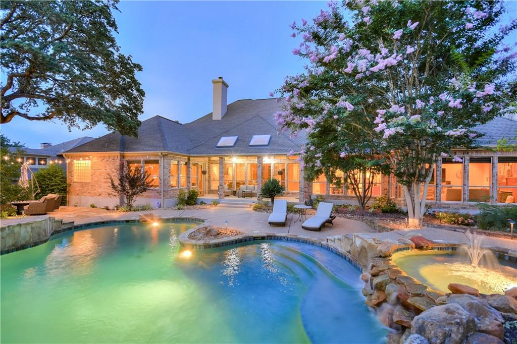 Gorgeous estate property on one spectacular street of sought out Oak Bluff Estates. Custom half acre estate lot with mature oak trees.  Multiple living areas, custom wood trim wood that is seldom seen. 3 car oversized garage, inground heated pool with waterfall feature. Outdoor covered grill and entertaining area is a one of a kind masterpiece. 4 bedrooms , 4 full bathrooms, extensive renovation. Expansive gourmet kitchen area is a must see that only the photographs begin to represent. Formal living area, formal dining area, plus an extra family room that is a must see.  The outdoor pool, flat work, custom flagstone, landscaping, oversized entertaining & cabana area were custom designed and built for current owner. Stunning backyard .