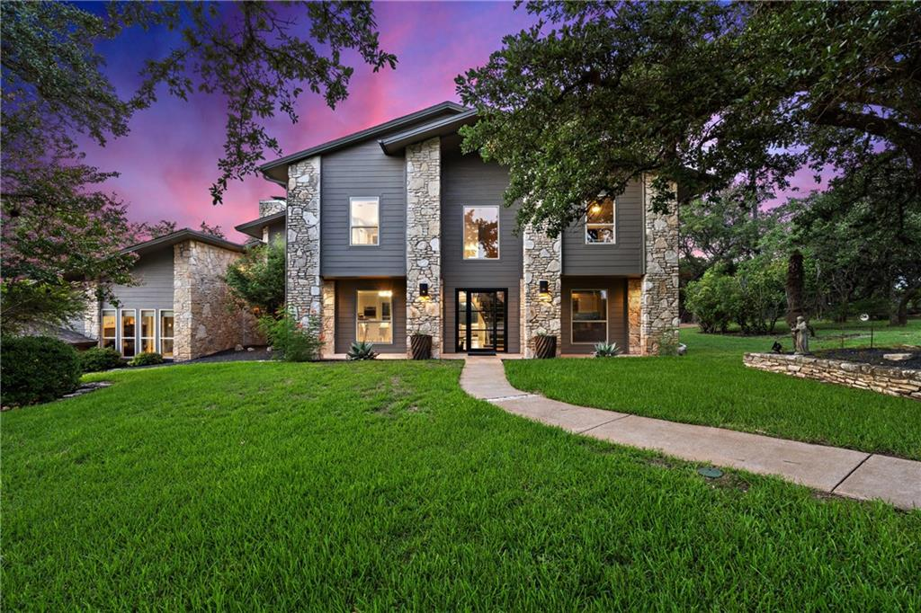 RARE opportunity on over 1.2 acres in the City of Lakeway! No HOA and zoned R-6 rural provides LOW taxes and ENDLESS opportunities for animals, boats, and more! Privately gated paradise with 25+ oak trees, circle drive, sparkling pool, garden, and hill country VIEWS! High ceilings, 2 fireplaces, SPACIOUS kitchen, and 2 lower level living areas. Oversized master on upper level provides tree house feel with miles of views! CONVENIENT to schools and shopping.  **Custom wood floors are being refinished, still time to select color**