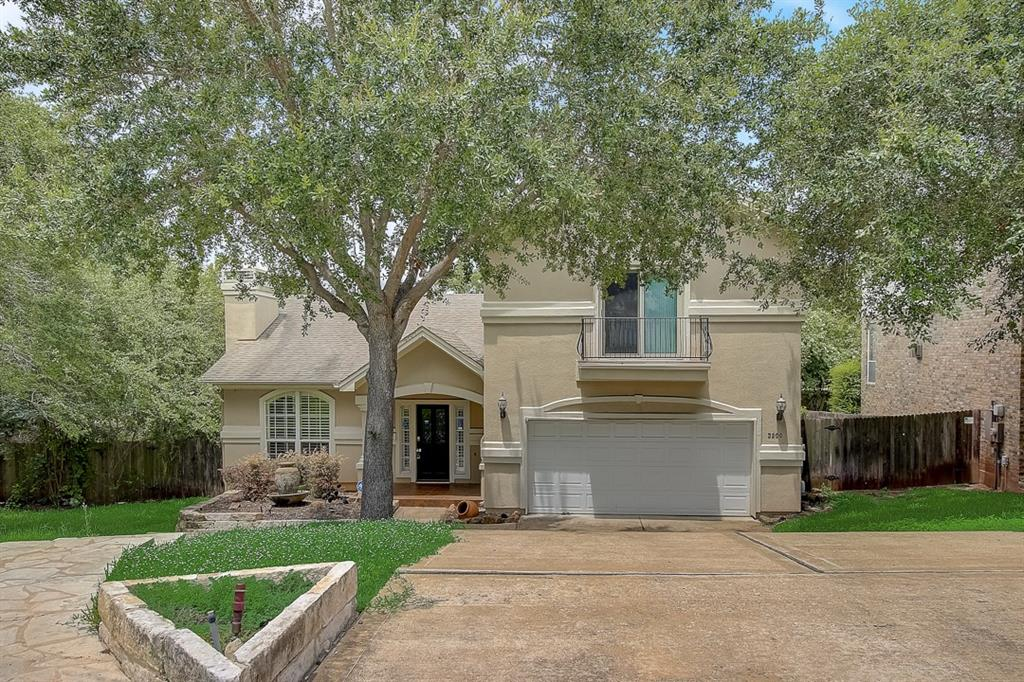 This Austin two-story home offers an in-ground pool, a patio, granite countertops, and a two-car garage.