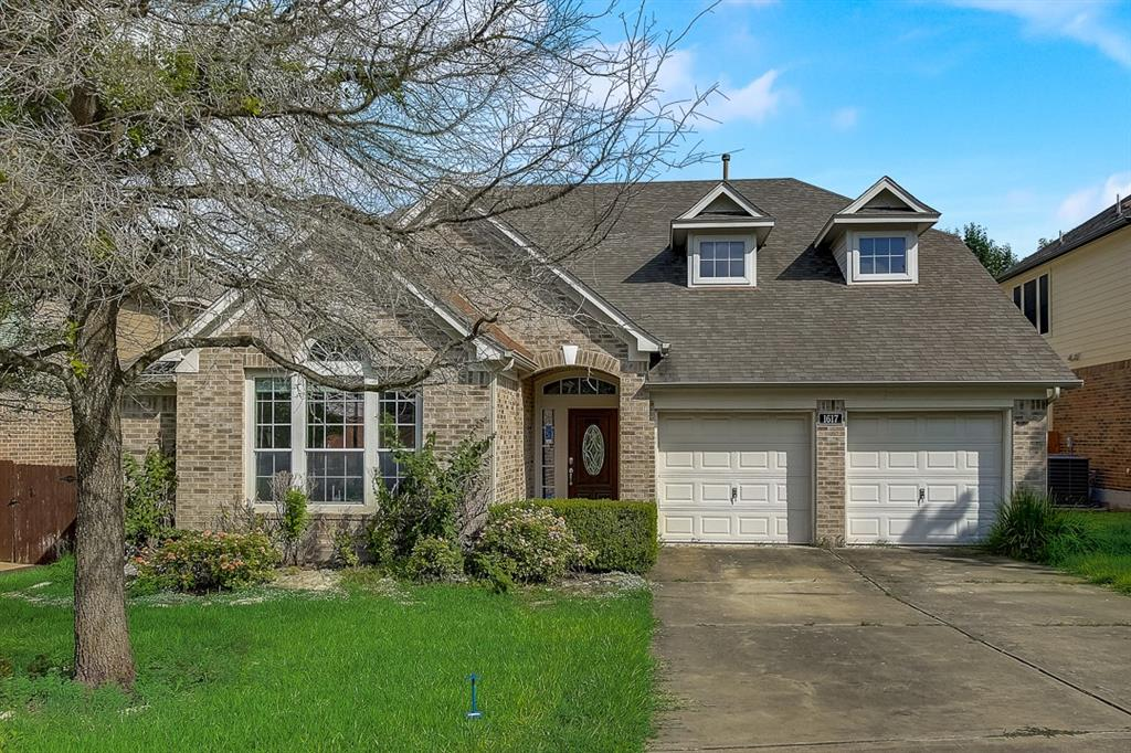 This Hutto two-story home offers a two-car garage.