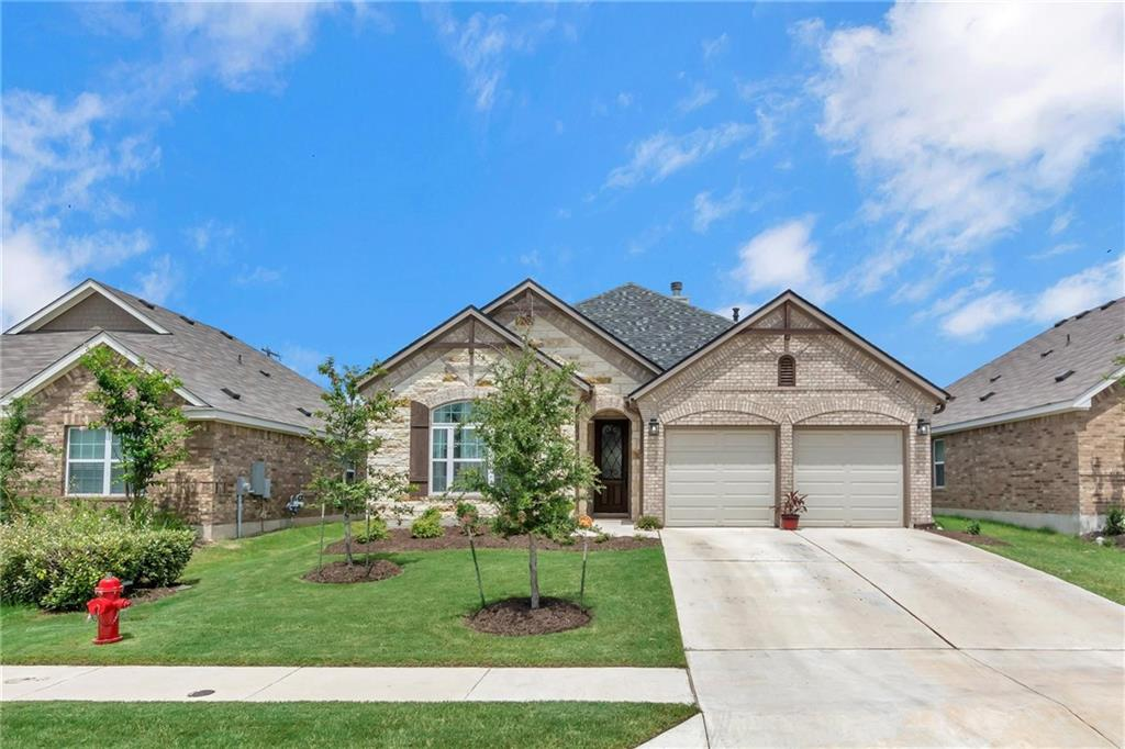 This stunning home was built in 2018 and boasts with pride of ownership. The outside features a brick and stone exterior with recent roof shingles, recent gutters, professional landscaping, and more. This backyard features a large covered patio with poly coated floor that is pre wired for surround sound, and pre plumbed with water and electric for an outdoor kitchen! Inside you will find upgraded wood like tile and luxury carpet with upgraded padding. The kitchen is sure to impress with it's granite counters, stainless steel appliances, gas cooktop and upgraded amply cabinetry. Don't miss out on this stunning home!