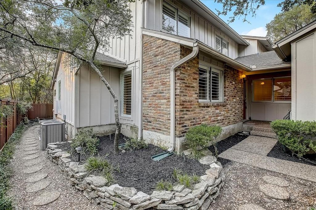 Wonderfully cared for 2 bed 2 bath condo in Summer Wood, an established town home neighborhood association with excellent location and reputation. Community amenities include green belt trails, community tennis courts, and swimming pool. Enter the home and notice the view of the soaring windows in the living room and take in the light and bright atmosphere. The living space features a fireplace and wet bar! Valencia tile covers the main floor giving it a resort-style feel. The primary bedroom is favorably located on the bottom floor, with its own access to the sunroom. Upstairs you will find a spacious loft space that could be used for a multitude of purposes, including a home office. The second bedroom and full bathroom can also be found on this floor. The yard features lots of trees, with a front courtyard and a spacious back yard as well. Welcome home!