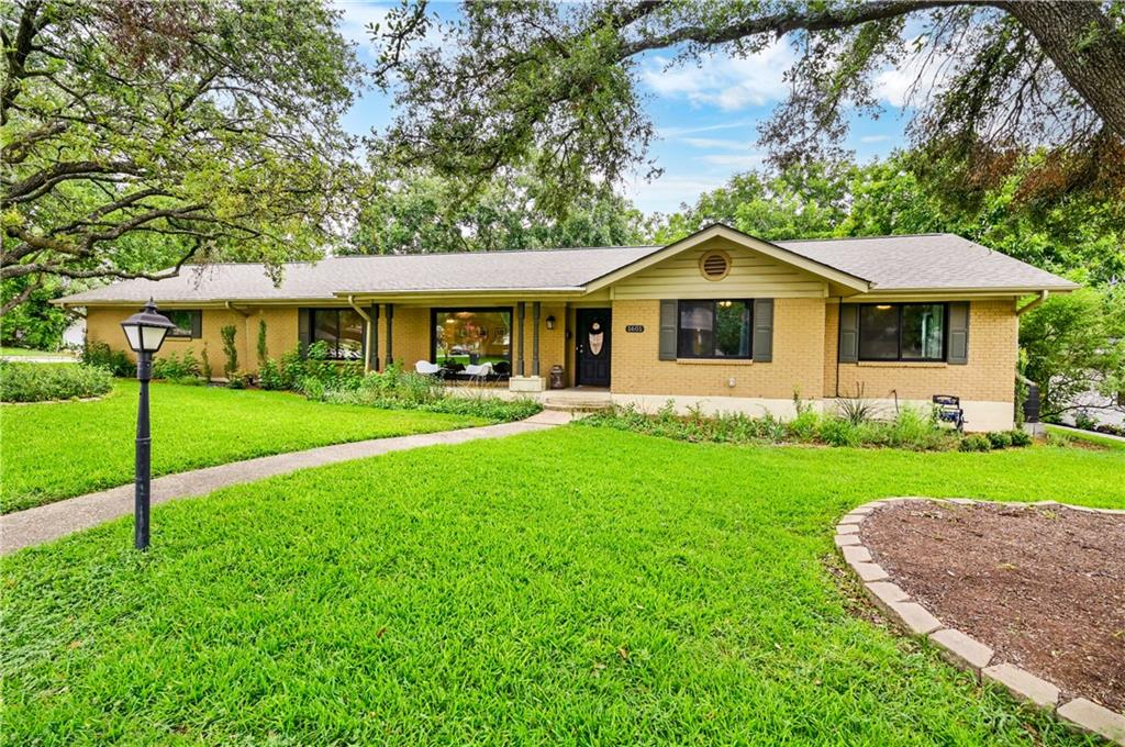 Tour this wonderful single-story home on a great corner lot. This home is close to all the necessities and more, such as the downtown square, restaurants, shopping, grocery store, along with easy access to I-35 or Toll 130. Mature trees provide great shade canopies. New windows that provide picture-like views and natural light. Beautiful wood floors in living area and kitchen. The enclosed porch is heated and cooled with stunning beamed ceilings.