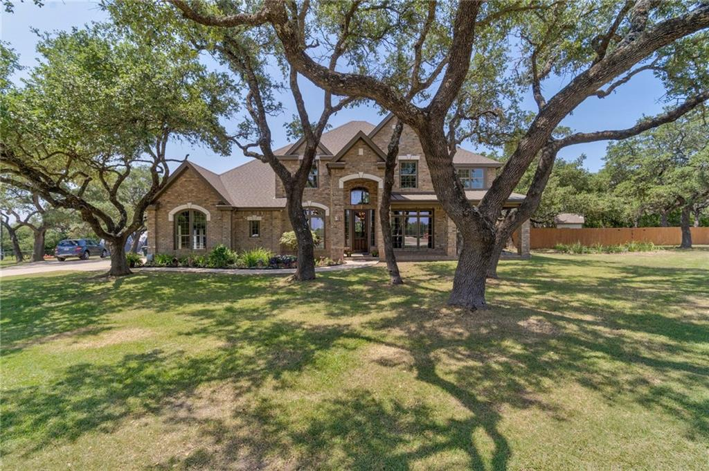 5.278 Acres groomed and landscaped with care, this stunning luxury mini-ranch and high-end custom home is gated w/unique ranch panel 5' pipe-fencing around perimeter  NO HOA, NO RESTRICTIONS.    From room for corralling your horses to comfort for the family, this property located on the outskirts of Buda yet close to everything Austin, has it all. Arranged as a full-on mini-ranch, the property boasts @ 5000 sq ft. , 5 bedrooms, 4 full baths, 1 half bath, barn, tack room, riding arena, 2 paddocks for any livestock, in-ground pool and waterfall, mature trees, and also is adjacent to wildlife paradise to back of property. This custom-built, David Weekley home is situated perfectly on this private sanctuary and boasts true attention to detail.  It welcomes you inside from a covered porch to view the sunsets and enjoy your outdoor pets. This property radiates pride and joy along with comfort and security– Buda mini-ranch is just waiting for your family to call it your new address and home!