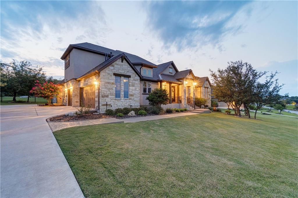 Gorgeous Luxury Hill Country Home in Dripping Springs' Vistancia Community. This stunning 4BD/ 3.5BA home features a sparkling pool & huge backyard on a 1-Acre Lot. The family room features abundant natural light, gorgeous tray ceilings with exposed wood beams, and a gas log fireplace framed in a striking floor-to-ceiling stone hearth. The gourmet island kitchen opens beautifully to the family room and boasts stunning granite countertops, breakfast bar, built-in double oven, gas cooktop, high-end SS appliances, a huge walk-in pantry, and a charming breakfast area nestled in bay windows overlooking the backyard. The elegant formal dining room is perfect for hosting holiday meals & dinner parties. Dedicated home office, front entry foyer, and Mud Room area at garage entry. The spacious Owner's Suite is tucked away on the main floor opposite the other bedrooms for privacy. The huge private ensuite bath will serve as your daily luxury spa getaway with a lavish garden soaking tub, large walk-in glass-enclosed shower, spacious separate vanities with granite counters, and a walk-in closet. The main floor features two of the secondary bedrooms that share a Jack-n-Jill bath with their own private vanities and walk-in closets. A stairway in the hall off the secondary bedrooms leads up to a beautiful Game Room loft area with designer wrought iron railings. A lovely second-floor guest bedroom with access to the upstairs full bathroom is the perfect private suite for guests. All bedrooms feature beautiful wood shuttered windows & walk-in closets. A backyard oasis made for entertaining & relaxing with a large covered patio outdoor living area with automatic shades overlooking the sparkling pool and enormous backyard. Roast smores under the Texas stars at the built-in firepit. Enjoy the 1-acre yard, build gardens, add a playscape, and more! Vistancia residents enjoy highly acclaimed Lake Travis ISD Schools (Bee Cave Elem/Bee Cave MS/Lake Travis HS).