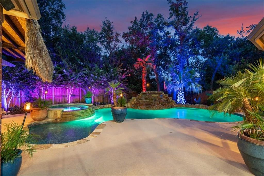 Your own private oasis! Kick back and relax in this Texas-sized home that's perfect for you and your loved ones. 5 bedrooms and 4.5 bathrooms, including downstairs guest quarters ideal for those who are less mobile. Love to party? Outside or inside, we have you covered! Heated gunite pool and hot tub with a Smartphone accessible control system, digital LED lighting, huge cabana with bar seating for 6+, outdoor kitchen with built-in grill and side burner, whole house and backyard sound system, and a putting green. Amazing kitchen with extra cabinets in breakfast area, butler's pantry, and walk-in pantry, all completely open to the living room. 3 bedrooms and 2 bathrooms (one Jack-and-Jill) upstairs, plus a game room, media room, Texas basement, and a 3rd floor air conditioned storage room. Gorgeous wood floors throughout main floor, new carpet upstairs in July '21, and freshly painted interior walls, trim, and ceilings. AC units replaced between 2019-2021. Extensive landscaping, mature oak trees, and backyard turf for easy maintenance. All of this with a coveted location in Hidden Glen, one of Round Rock's most sought-after and established communities, with fantastic schools and an easy commute to I-35.