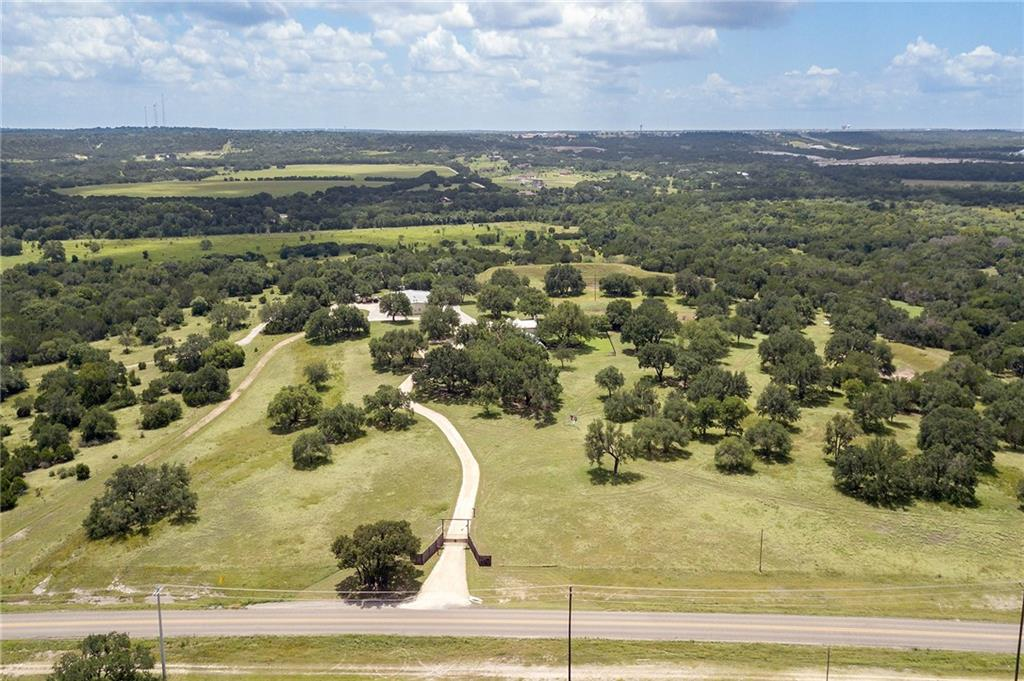 """One of a kind country estate in Georgetown!  17 acres off FM 3405 groomed to perfection.  3723 square feet of custom home.  Stunning great room with 17 foot ceilings.  Master suite with his & hers showers and sinks and separate walk in closets.  Additional Master Suite as well!  Huge 13 x 19 utility room with tons of storage.  Open kitchen design with top of the line GE stainless appliances and 48"""" Built in refrigerator.  Large walk in pantry.  2 wood burning fireplaces.  Large living area with beautiful wood floors perfect for entertaining with a sitting area as well.  Separate wing with 3 bedrooms and 2 bathrooms.  Screened in back porch and patio that looks out into a perfectly landscaped backyard and outdoor patio and entertaining area plumbed for gas firepit.  Sprinkler system.  70 x 100 overall shop includes 870 square foot apartment with 2 bedrooms, 1 bath, full kitchen, living room and covered porch.  30 x 30 office/workshop and half bath.  18' x 60' enclosed RV storage.  50 x 70 covered storage/parking area.  20 x 20 enclosed Barn and fenced pens for livestock, garden and chicken coop.  Minutes from Lake Georgetown.  This is truly a spectacular property for those wishing for the peace and quiet of country living yet close enough for the amenities of Georgetown and Austin."""