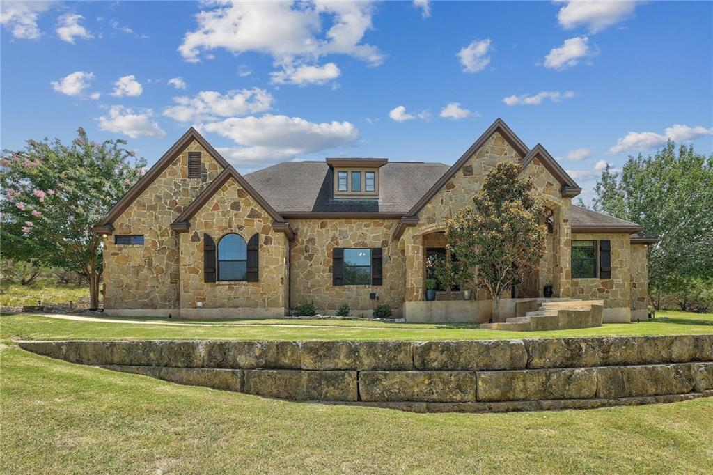 Privacy, privacy, privacy! A perfect slice of hill country in a neighborhood setting, the best of both worlds! This home sits on over 2 acres at the end of a quiet culdesac, surrounded by trees. Enjoy your morning coffee on your secluded covered patio while listening to the birds. This well maintained custom home features vaulted ceilings, custom stained and scored concrete flooring, and plenty of natural light throughout. Once inside the home, take note of the private home office to your right, and the floor to ceiling stone fireplace with a custom wood mantle in front of you. The gourmet kitchen includes a center island, breakfast bar, stainless steel appliances, and a gorgeous copper vent hood. With a formal dining room, and breakfast nook, there is plenty of space to host guests. The primary bedroom is surrounded with windows, overlooking the serene backyard. Separate his/her closets and a large primary bathroom complete this suite. Also on the main level is a laundry room with a utility sink and built in ironing board, 3 additional bedrooms and two more full bathrooms. Upstairs you'll find a sprawling game room with an abundance of storage, and another full bathroom. Other upgrades include: solid wood front door, copper sink in guest room, custom wood work around windows, plank wood ceilings at entry way and back patio, and a custom fire pit in the backyard. Community features include: a pool, playground, nature trail, and fishing pond. Located near Dripping Springs ISD outstanding schools. Near by you'll find: retail, dining, theaters, numerous breweries and more. Quick access to Austin, Johnson City and Fredricksburg. This one of a kind home will not last!