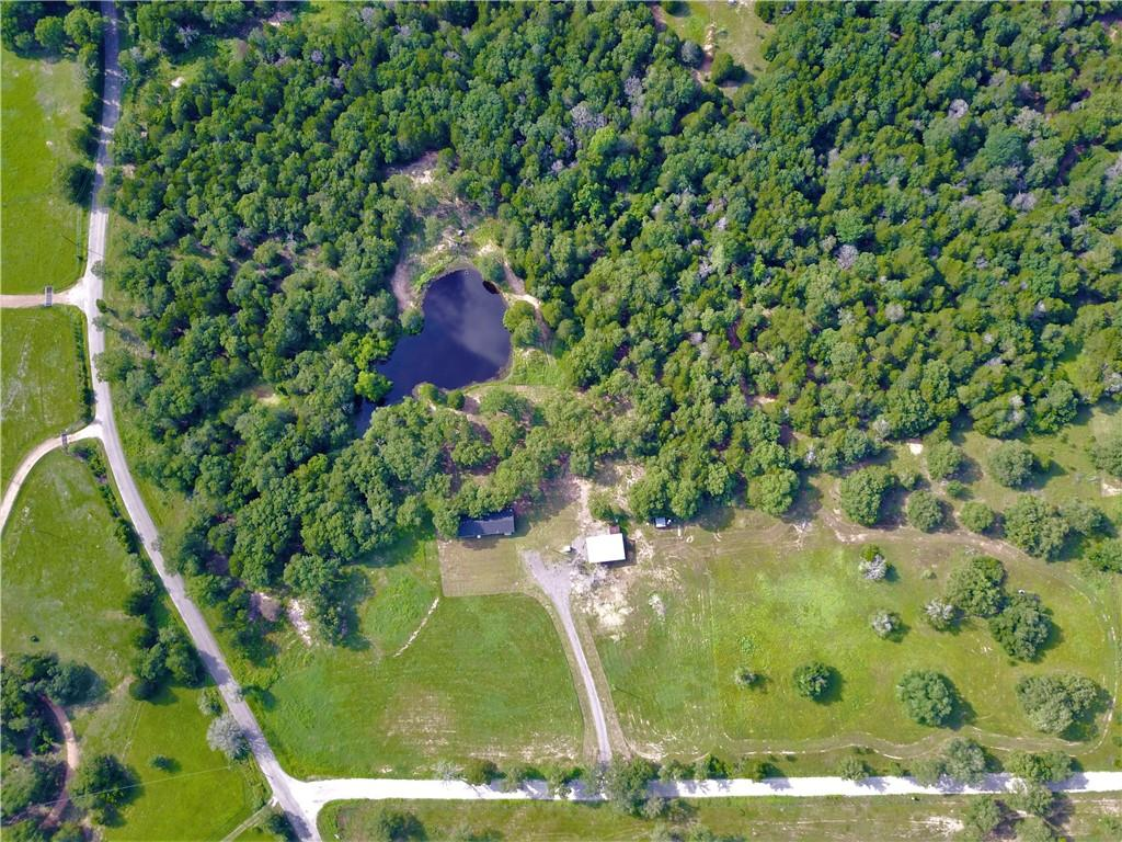 Beautiful 11+ acres located just outside of Smithville off of Hwy 95 S. Property is on the corner with an abundance of trees & a large tank. Home is a 2001 mobile home with 3 bedrooms and 2 full bathrooms. Roof was replaced in September 2020 and brand new a/c unit as of July 2021. Pipe entrance was recently installed and a gravel road leads to a great open area where the home currently sits. 40 x 30 pole barn was put up about 1 year ago. This property has all the perks of living the country life but is not too far from town.