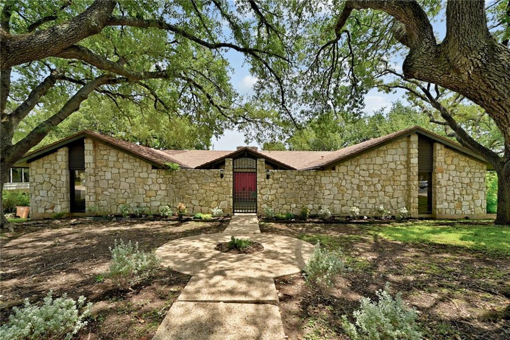 Incredible opportunity to own a mid-century original in gorgeous Onion Creek. Positioned on the 18th hole of one of the most beautiful courses in Austin, 2408 Pebble Beach is walking distance to the clubhouse and provides views for miles.  This Lyndon Crider Custom Homes built- and Wyatt E. Ewald designed-ranch-style home is ready for the 3rd owners- live in this original or bring your ideas and make it your own. 2408 Pebble Beach is a sprawling one-story and features four bedrooms, each with its own en-suite. One suite serves as a true guest quarters, with separate entrance and full retro kitchen.  Downstairs offers a Texas basement, with ample space for an office, craft room, den, or storage.  Enjoy country club community living and all the Texas stars, just 12 miles from Downtown Austin.