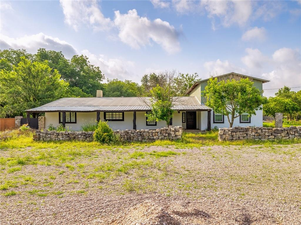 At 3.81 acres, this remarkable property with Lampasas River frontage represents an incredible opportunity to bring your dream home to life or create a working farm or ranch. Originally purchased by the seller to remodel, now is the perfect time to take those renovations over the finish line or clear the land for use. The current residence includes three bedrooms, one bathroom, kitchen, dining room, living room, laundry room, and a sizable unfinished space that could be reimagined as a spacious primary suite or a great room with a loft above for an office. With a distinctly Texan personality, there are many extraordinary features, including soaring ceilings, rich wood beams and accents, decorative stonework, stone fireplace, woodburning stove, clawfoot tub, and standing shower. A new-in-box washer, dryer, range hood and Semihomemade brand kitchen cabinets are included in the sale; the purchaser would just need to install them post-closing. All other tools and remodeling materials currently in the home also included in sale. Walking path to river frontage needs a simple clearing and leads to a great fishing spot. Park your RV, farm equipment, large tractors, store your boat, or build a huge workshop or two–this property is both versatile and subdividable. Sold as-is. Per local zoning authority, No restrictions! Your piece of Texas awaits you. Bring your vision to life right here.