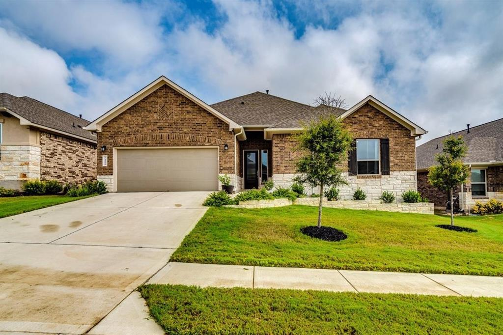 This Dripping Springs gem is a 2019 Scott Felder Home in the highly coveted Caliterra neighborhood, offering exemplary schools, community parks and trails, coffee house, splash pad, fishing docks, pool, and more.  Everything in the Dripping Springs is a very short drive from Caliterra but you'll feel miles away in this sprawling neighborhood.  The home is located on an exterior lot with peaceful undeveloped land to the rear.  Inside, you'll find this home offers it all in 2,586 square feet.  The entry opens into the great room with adjoining kitchen, breakfast bar, breakfast room, and an extended covered patio.  The master suite has  high ceilings, serene views to the rear, dual vanities, separate shower and corner soaking tub, and a huge closet.  Secondary bedrooms maintain separation of space with small hallways off of the living and foyer, and everyone stays happy with 2 additional full baths.  The 3-car tandem garage provides that extra space you need while maintaining attractive curb appeal.  Finishing touches are already done, making this house a home.  They include upgraded wood floors, cabinet hardware, custom bench and cubby in the mudroom, designer interior paint, draperies, and full exterior gutters.  Come see this listing ASAP, and you'll fall in love with this home and its location in Caliterra. Follow virtual tour link for Matterport Virtual Tour with additional photos.  Buyer to verify applicable tax rate.