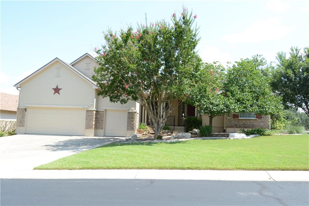 Located on the Legacy Hills Golf Course, this Travis model home offers multiple dining and living areas; 3 beds (2 with bay windows); 2 baths; a kitchen with granite counters, stainless steel, built-in, double electric, self-cleaning ovens, stainless steel dishwasher, microwave, and gas cooktop; a family room with gas log fireplace and built-in bookcases and cabinets; an oversized garage with parking for 2 cars and a golf cart, a workbench, and lots of storage (cabinets and overhead hanging); laundry room with sink and cabinets; front porch with water feature; large, covered back porch with shades; a walkway with no steps from Scissortail Trl to the back door and porch; a fenced-in backyard; and mature landscaping and trees. Flooring is a combo of wood, carpet, and ceramic tile. HVAC replaced in 2018. Roof shingles are approximately 1 year old.