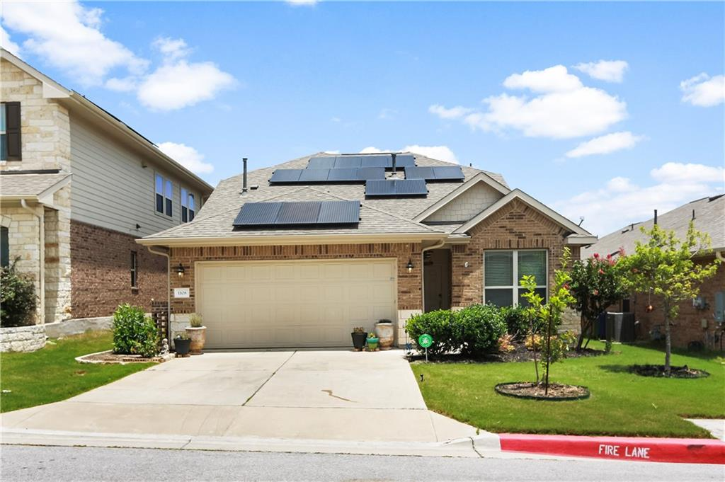 This charming home has no back neighbors and is walking distance from hiking trails, playground, disc golf course, and even a fenced dog park! Must see views of the greenbelt and pond from the back patio and second floor. (Make sure to check out the drone footage link!) Solar is leased and transfers with ownership. Roomy primary suit is located on main level. Luxurious primary bath has natural light for days, privacy window, garden tub, separate shower, and don't forget to check out that designer closet! Perfect for all stages of life this house has a mother-in-law floorplan with two secondary bedrooms on MAIN level. Upstairs sports a large second living area/flex space and spacious 4th bedroom next to a 3rd full bath. All this and only minutes away from access to major employers and shopping. A remarkable opportunity for owner occupiers and investors alike!