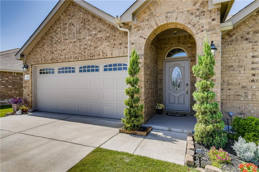 Charming single story, 4 bedroom, 3 baths, open floor plan, and tastefully updated home in the desirable Hutto Highlands community. Stunning kitchen with large center island and stainless steel appliances.  ?Interior features include gorgeous tile flooring, granite counters, stainless appliances, and clean/neutral accents. primary suite on the main level with walk-in closet, dual vanity, separate tub and walk-in shower. Exterior features include native landscaping, gutters, and a HUGE entertaining patio/deck! Great location only minutes from Toll 130 and HWY 79!Vaulted ceilings.
