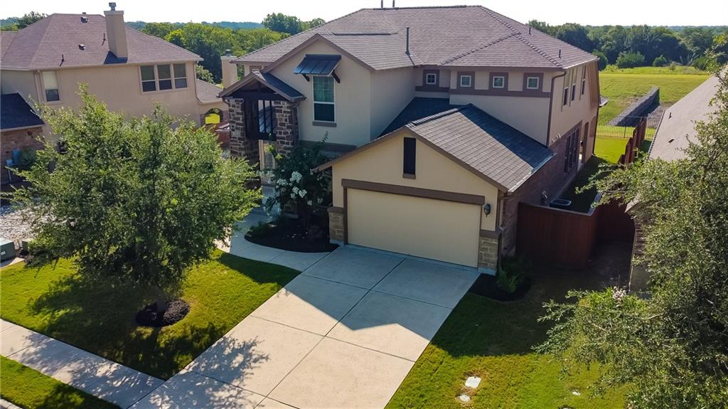 The oversized entry porch is a great greeting area or entertaining area for guests. 8' solid wood entry door leads to an open, bright floor plan. The neutral color palette will suit any decor, open pristine condition ready for new owners.  The extended covered back patio is on a greenbelt offering views & privacy &  is prepped for an outdoor kitchen. The large kitchen features lots of granite counter space, an abundance of cabinets, a preparation island, double ovens, pantry & gas cooktop. Both Owner's Retreat & Guest Suite are on the main floor. Master has his/hers vanities, soaking tub, separate shower, 3 tiered clothes rods in large walk-in closet. The office has wood floors with a pleasant view of front porch.  Upstairs you will find a loft that could be a playroom or another office, 2 secondary bedrooms, full bath, and a media room wired for surround sound & theater lighting. 2021 Roof- 2021 Gutters - 2021 Exterior Paint - 2020 HVAC unit with UV light. Great neighborhood near Brushy Creek Walking Trails, Community Pool & Playground.  This home has it all.
