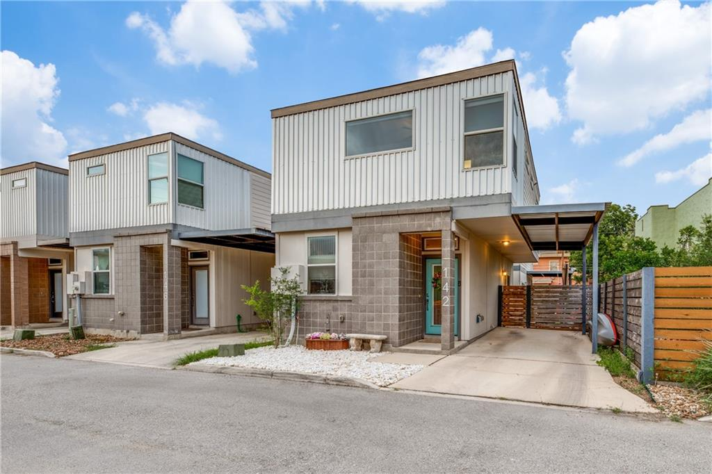 Gated Community. Park across the street, enter pedestrian door to the right of gate. Located in the heart San Antonio's historic Tobin Hill, this great property lies in a gated community with easy access to tons of downtown San Antonio and Southtown fun! A quirky, contemporary style immediately greets guests and lends to the charm of living here. The first floor features open-concept living and dining areas, overlooked by a modern kitchen with stainless steel appliances, rich cabinetry, and island workspace. A powder bath completes the main level and makes entertaining a breeze! At the top of beautiful hardwood stairs, two large bedrooms (both with blackout blinds) and a small loft (may easily function as a study/home gym) are perfect for relaxing and unwinding at day's end. Two full baths are also found upstairs along with a laundry closet providing space for stackable units. Additionally, a private patio allows for outdoor living and festive barbecues. Hard to find in this area, owners will also enjoy rare covered parking. Centrally located near downtown San Antonio, the Pearl, and major highways, this fantastic home is a must see!