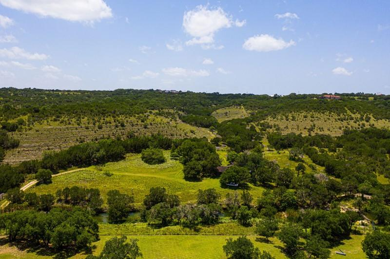 Beautiful Hill Country tract with awesome views!!! Great place to enjoy family, friends or just get away and fish or enjoy the great swimming hole with several feet of lone man creek. You may not want to swim or fish so get on your hiking boots and enjoy a great hike in the hills. Plenty of opportunities on this beautiful property. There are some great location to build that perfect dream home. Property is fully fenced with gates. There is a very old cabin on the property with a water well, electricity and septic. Current Ag Exemption in place on property. MUST SEE!!!!