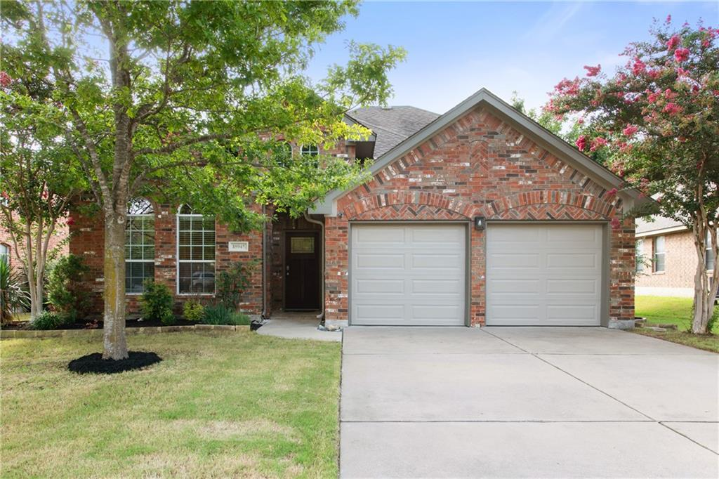 This lovely 1.5 story home is located in the HIGHLY desired neighborhood of Falcon Pointe. Inside enjoy the private home office, open plan, primary bedroom, and secondary bedrooms being on the main level. Updates/upgrades include spray foam insulation in the attic, new A/C 2020, new water heater 2020, new carpet 2020, new garage doors 2020, and epoxy garage floors. Large kitchen with granite counters, center island, tons of counter and cabinets, stainless steel appliances and hardware, and subway tile backsplash. Bright breakfast area with a gorgeous light fixture. Living room with tile hardwood-looking floors, ceiling fan, gas fireplace, and surround sound. Large primary bedroom with oversized windows overlooking the private backyard. The primary bath features double vanity, garden tub, separate shower, surround sound, and walk-in closet. Upstairs features a large room that would be perfect as a guest bedroom, secondary primary bedroom, or game room with a barn door, private full bathroom, and walk-in closet. Outside is the perfect place to relax and entertain under the covered patio with recessed lighting on the extended patio. Enjoy the privacy of an extra high back fence. The yard is equipped with a full sprinkler system. The home sits in a prime location of the neighborhood within walking distance to all 3 schools and the amenity center with 3 pools, splash pad, pavilion, workout center, clubhouse, and hike/bike trails. Easy access to Stone Hill, Restaurants, Costco, Typhoon Texas, and Toll Roads. A Must See!!