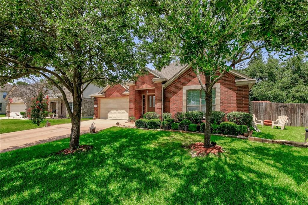 Stately home with stunning brick exterior located in highly sought out Red Oaks community in Cedar Park. This is the perfect time to get into this fantastic area just minutes from the hot up-and-coming Bell District. This beautiful 4BD/2BA one-story home features a beautiful functional open floor plan with vaulted ceilings and elegant archways. Keep warm and cozy in the winter with the wood-burning fireplace. The formal dining room is the perfect place to host holiday meals and dinner parties. The home chef will love the classically elegant kitchen with tastefully stained cabinetry, granite countertops, center island with breakfast bar seating, stainless appliances, built-in oven & microwave, and gas cook top. Gleaming hardwood floors in the owner's suite, family room, and dining room. The Owner' Suite serves as a peaceful retreat for rest & relaxation and boasts a sizable walk-in closet. The luxurious ensuite bath offers a lavish garden tub, separate glass-enclosed shower, and spacious dual vanity. A covered back patio is the perfect place to relax in the shade and features an extended wood deck for lounging in the sun and a BBQ Grill. This home offers a huge private fenced-in backyard with mature shade trees and lush green lawn. Residents enjoy all the amazing Red Oaks amenities including a community pool, park, playground, and pavilions for events. Excellent Leander ISD Schools (Reed El/ Henry MS/ Vista Ridge HS). Close to fantastic shopping, dining, and entertainment (Lakeline Mall, The Parke, 1890 Ranch) with more on the way (Bell District). Short drive to Brushy Creek hike & bike trail and the amazing Lakeway Park project that is coming soon. Easy commute to the nearby North Austin tech corridor. This is a hot up-and-coming area in Cedar Park. This listing will not last!