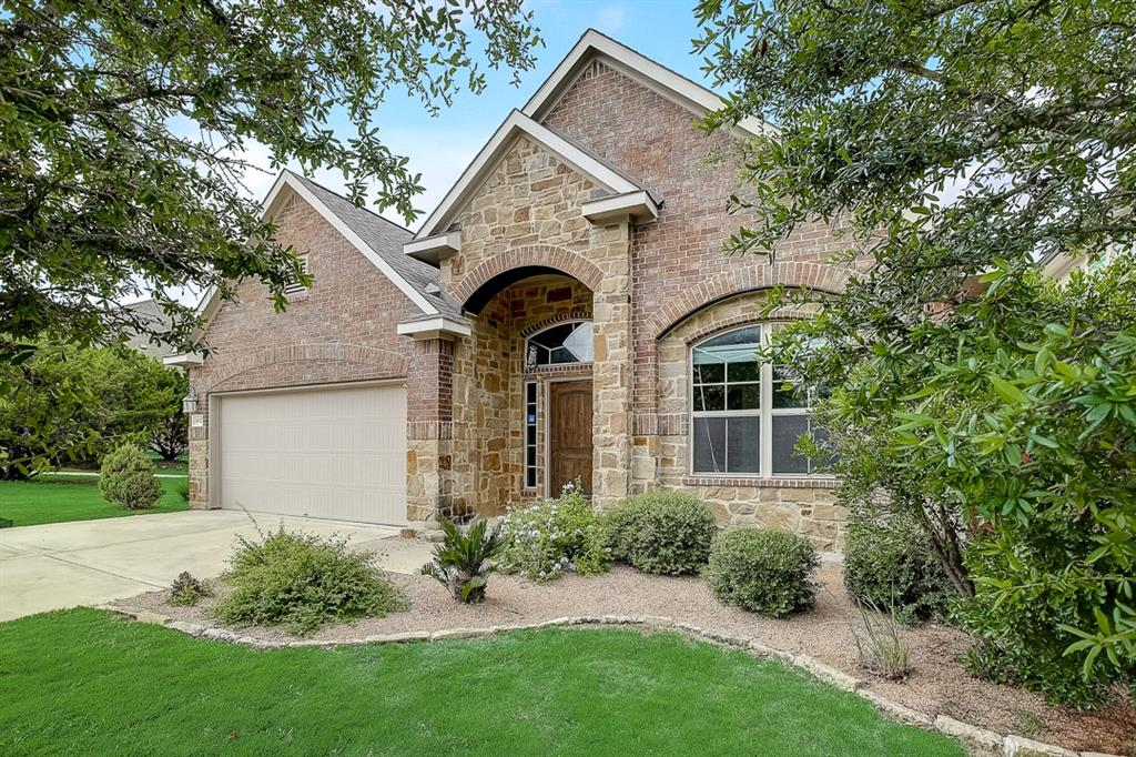 Built in 2014, this Austin two-story corner home offers a patio, quartz countertops, and a two-car garage.
