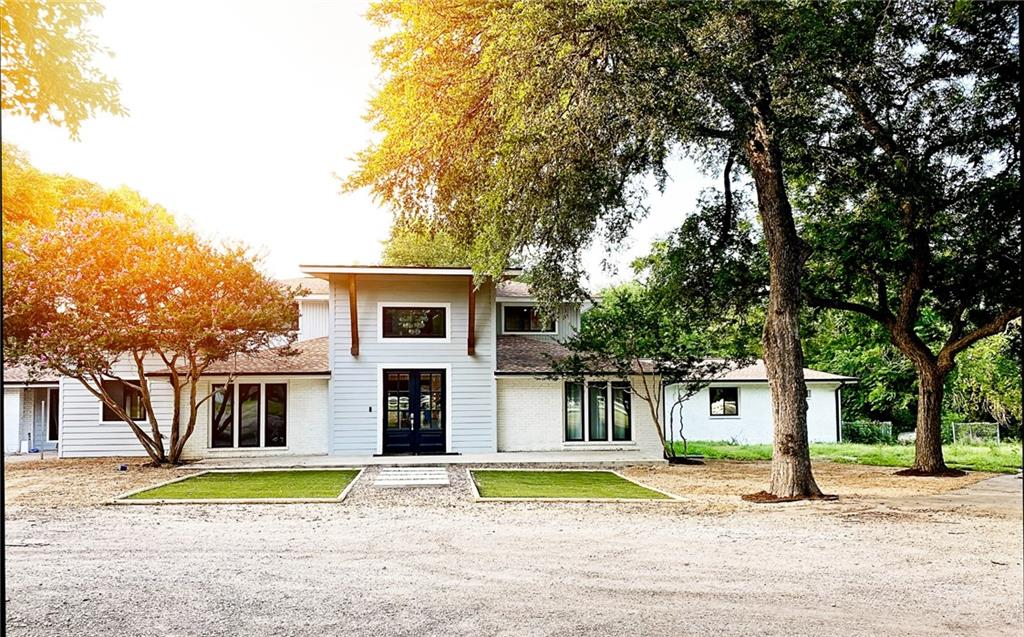 Dream home living on this private slice of heaven! Stunning 4800 sq ft custom home tucked away amongst 7 acres of abundant mature trees and creek frontage. Located in the heart of Round Rock with secondary custom home build site included. Complete floor to ceiling renovation in 2018. High end and designer finishes throughout. Great open floorplan with bonus media room and dream backyard complete with pool, large covered patio and 4500 sq ft of artificial grass. Perfect for a family compound. Bring your horses, your outdoor toys and your creativity! Quiet dead end street with only 4 neighbors spread out over 200 acres. Country feel with city amenities! Walking and biking to restaurants, parks and trails. HEB, Walmart, dining and shopping all within 5 minutes. A RARE OPPORTUNITY!