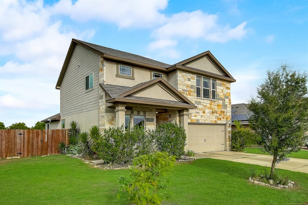 Built in 2014, this Pflugerville two-story home offers a patio, granite countertops, and a two-car garage.