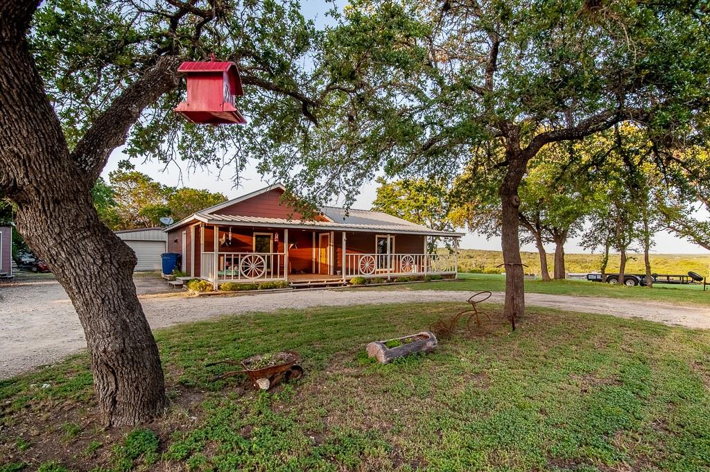 Incredible Hill Country views on 2.453 Acres in the beautiful Hill Country on the periphery of Leander! This gorgeous property has been cleared and sloped to provide outstanding panoramic views of the surrounding hills. The beautiful Rustic Kitchen and Dining area open into a comfortable living room with large windows that provide natural light and views of the adjacent hill country. Relax in the Owner's Suite with luxurious Jetted Tub and separate Walk-in Shower. In addition to the lockable Walk-in Closet in the Owner's suite, you will find a second, spacious walk-in in the Owner's bath. Gated Entry with Circle Drive provides plenty of parking. On site RV hookup and room to store recreational vehicles. The 12x16 storage shed is only 4 years old & has a roll up door. Sparkling chlorinated Pool attached to the back porch lets you relax and swim with views you'll have to see to believe! Bring your hiking boots, mountain bikes, four-wheelers, swim suits, animals, and all your toys -  there is room to do it all here!
