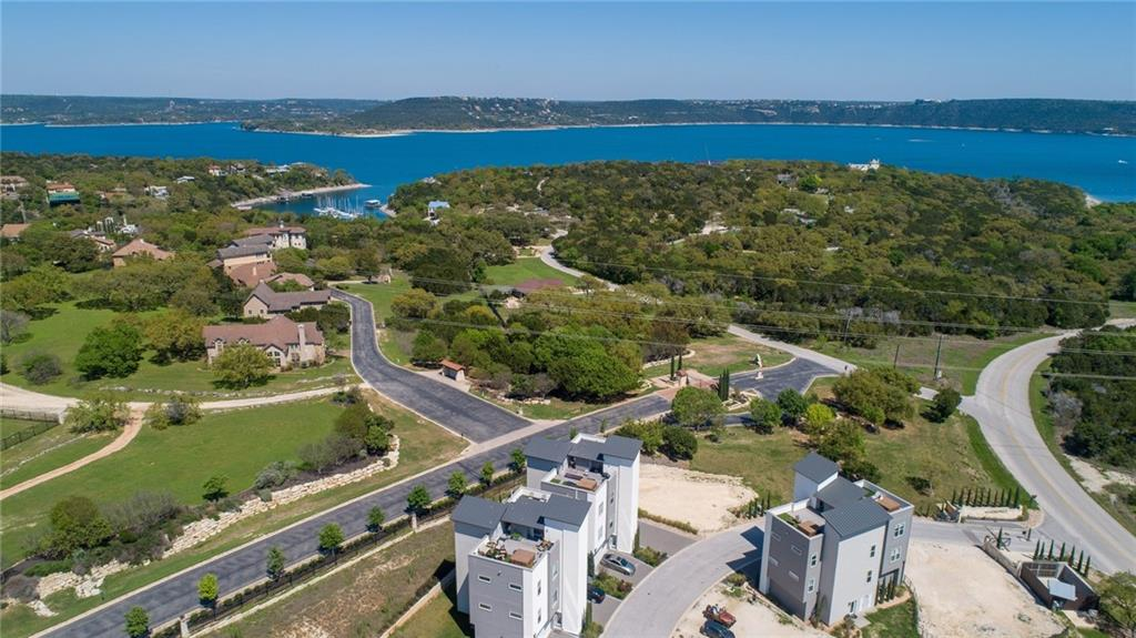 Enjoy views of Lake Travis from your private rooftop patio in the hot tub or watch the game on the wall-mounted TV.  Then take your private elevator down to your unit where you have an open living, dining and kitchen area. A small private office is just behind the kitchen. Primary bedroom is spacious with an ensuite bath, tile floor, large walk-in glass shower, walk-in closet and dual separate vanities, and enclosed water closet. Just 1500' to Mansfield Dam park where you can launch boats, swim, or cookout. This condo project is now in phase II and nearly sold out. This unit is turn-key and ready to move in. It also has many upgrades over the entry level newer units. This unit has one of the best lake views of them all! This won't last long.